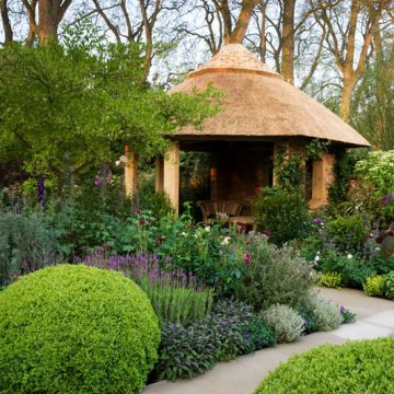 May Centenary M&G Investments Centenary Windows Through Time garden Gold medal floral English garden steel circle sculpture thatched garden building summer house classic planting flair Roger Platts RHS Chelsea Flower Show 2013