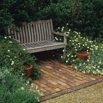 bench seating area in quiet and cosy part of the garden designer by Roger Platts