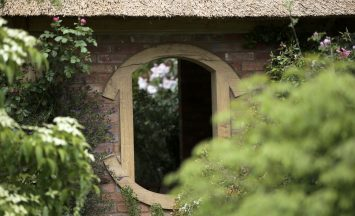 Garden Building at The Chelsea Flower Show thatched summerhouse M&G Garden 2013 Roger Platts