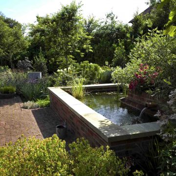 Garden Design in London. Water feature in landscaped garden