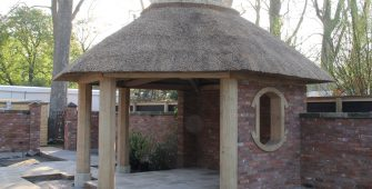 oak summer house with thatched roof, manufacture, supply and installation. This one for The RHS Chelsea Flower Show