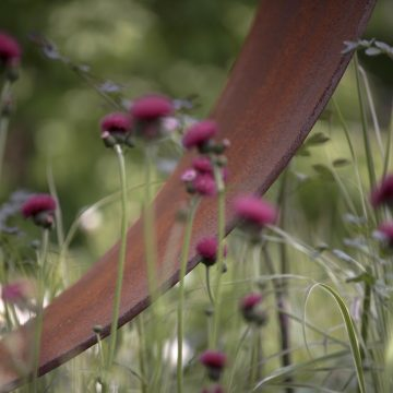 planting and sculpture in traditional garden
