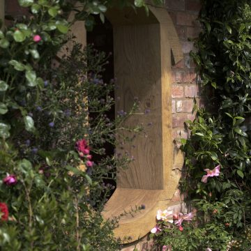 Romantic planting roses climbing up the summerhouse