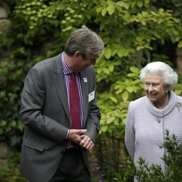 The Queen with Roger Platts walking through his garden at The Chelsea Flower Show in 2013